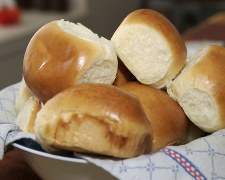 A basket of warm rolls fresh from the oven.