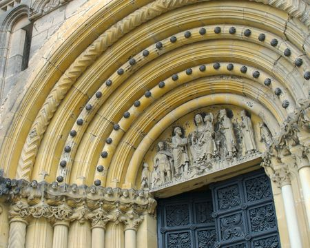 The ornate arch over the main entrance to Bambergs Imperial Cathedral Stock Photo