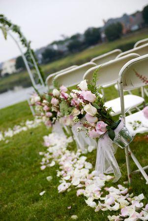 A tilted shot of an outddoor wedding aisle.