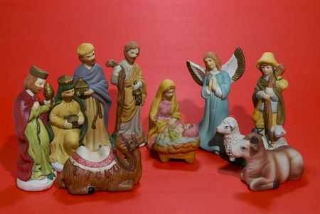 A ceramic depiction of the Nativity isolated against a red background. Stock Photo - 2174087