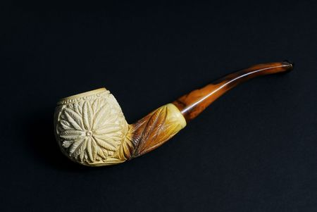 A Meerschaum Pipe isolated against a dark background.