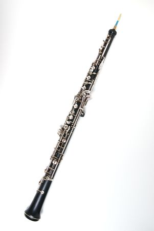 double reed: An oboe isolated against a white background.