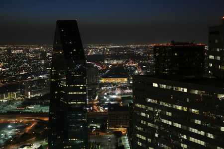sprawl: A view of the Dallas night scape from on top of a high rise.