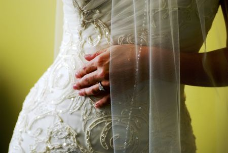 A photograph of a Brides beautiful shape.  The focus is on the ring and falls off towards the fingertips due to the shallow depth of field. Stock Photo