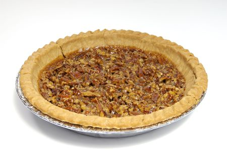 A pecan pie isolated against a white background.