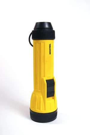 A yellow flashlight shot against a white backkground. Stock Photo