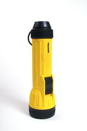 A yellow flashlight shot against a white backkground. Stock Photo