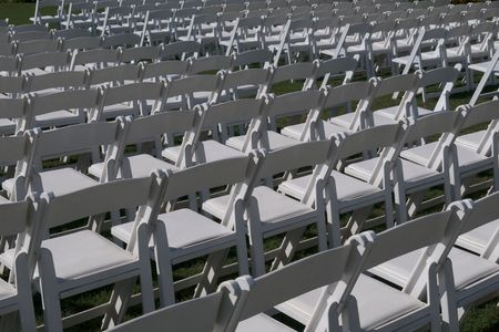 aisles: Several rows of white chairs. Stock Photo