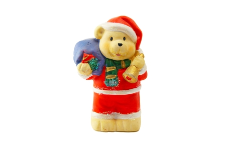 A New Years toy - a figure of a bear with a bag and in a suit santa klaus Stock Photo