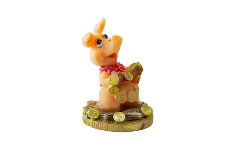 A figure of a toy pig with money. photo