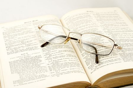 Glasses laying on the old book