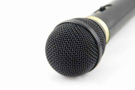 black microphone on a white background.