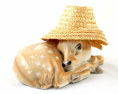 A decorative figure of a laying deer in a hat. Stock Photo