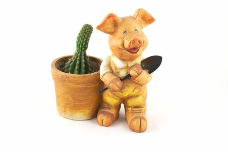 A flowerpot - a pig with a shovel on a white background