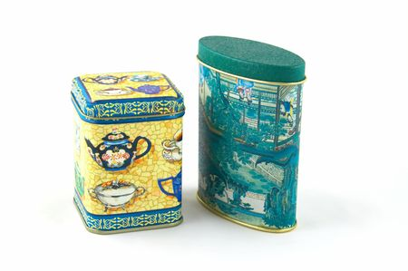 Painted tin box for storage of tea Stock Photo