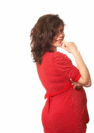 Portrait of the pregnant woman in a red dress with white points Stock Photo