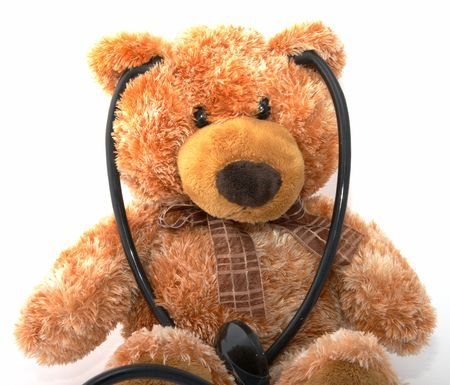 The teddy bear with a stethoscope on a white background Stock Photo - 3100041