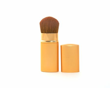 Soft cosmetic brush on a white background photo
