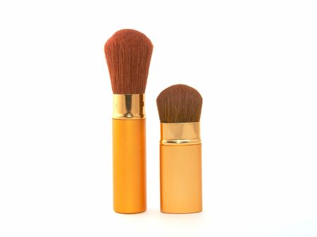 Soft cosmetic brush on a white background