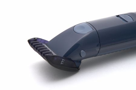 The electric machine for a hairstyle of hair on a white background