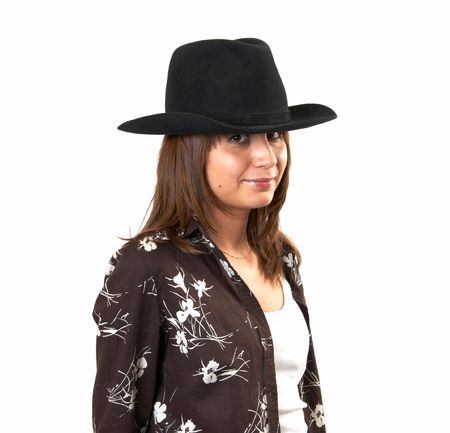 The girl in a brown jacket and a cowboys hat