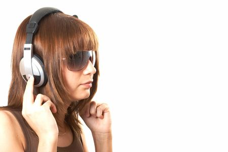 The girl in brown with headphones on a white background