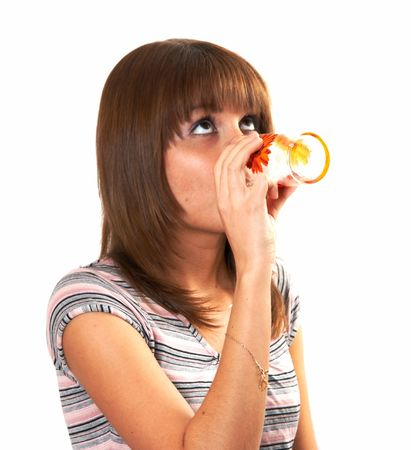 The girl drinking juice on a white background
