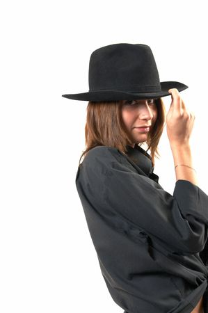The girl in a black shirt and a cowboy's hat  Stock Photo - 3138532