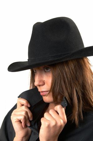 The girl in a black shirt and a cowboys hat  Stock Photo