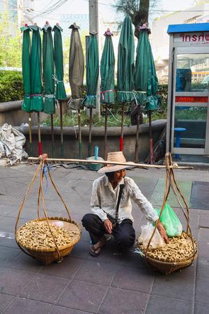 sidewalk sale: Peanuts seller, Bangkok, Thailand, Asia