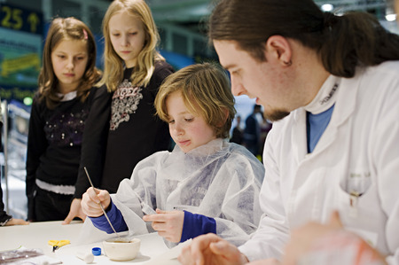 fairs: Children at the booth of the Federal Ministry for Education and Research, Green Week 2010, Berlin, Germany