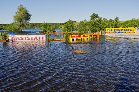 overrun: Flooded snack bar on the Oder River, Oder flood in 2010, Krajnik Dolny, Woiwodschaft West Pomerania, Poland Editorial
