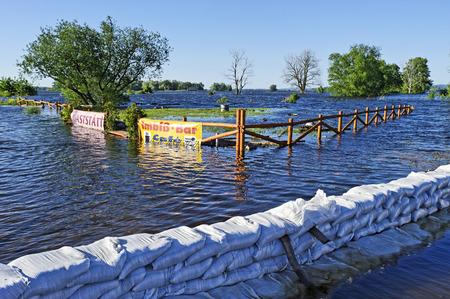 sandbag: Flooded snack bar on the Oder River, Oder flood in 2010, Krajnik Dolny, Woiwodschaft West Pomerania, Poland Editorial