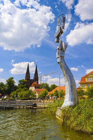 vertical format: Parzival statue, a sculpture made of stainless steel at Ruppiner Lake, Neuruppin, Germany