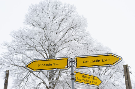 winterly: Signpost in Muehlenbeck, Mecklenburg-Western Pomerania, Germany