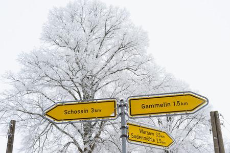 wintriness: Signpost in Muehlenbeck, Mecklenburg-Western Pomerania, Germany