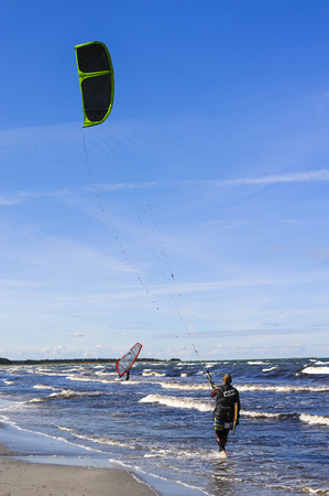 sportingly: Kite surfer on a beach Baltic seaside resort of Prerow
