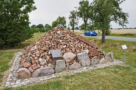 lower value: Denkpyramide or thinking pyramid, memorial for the forced relocations of the Operation Vermin in 1952, Vockfey, Lower Saxony, Germany