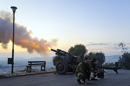 muzzle flash: Shooting salute at Mount Lycabettus, Athens, Greece