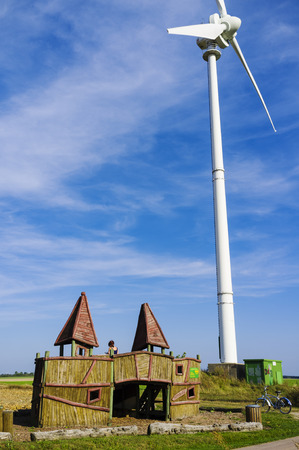 Resting place and wind turbine at Flaeming Skate near Jueterbog, Brandenburg, Germany photo