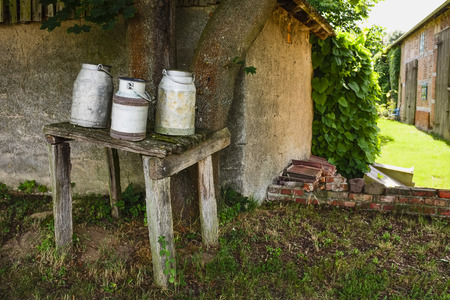 milk cans: Milk cans on a bench, Wanzer, Saxony-Anhalt, Germany