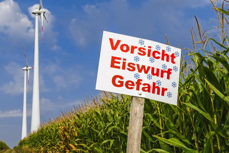 Danger sign in front of wind turbines near, Wustermark, Germany photo