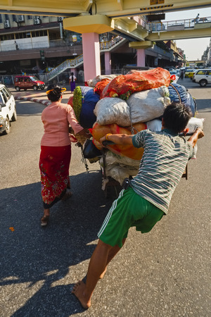 hand cart: Street seller with hand cart, Yangon, Myanmar Editorial