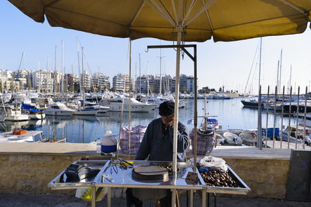 zea: Roast chestnut street vendor at Zea Marina, Piraeus, Greece