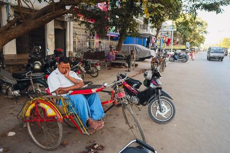trishaw: Sleeping Trishaw driver, Mandalay, Myanmar, Asia Editorial