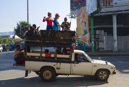 80th: Van with public-address system, 80th Street, Mandalay, Myanmar, Asia