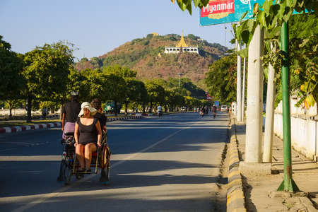 trishaw: Tourists on trishaw, road to Mandalay Hill, Mandalay, Myanmar, Asia Editorial