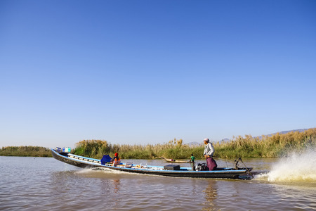 lake shore drive: Longboat on Inle Lake, Myanmar, Asia