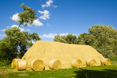 Covered stack of straw bales, Brandenburg, Germany