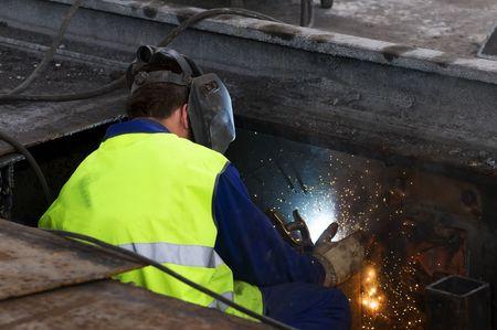 girder: worker is woking to welder iron girder